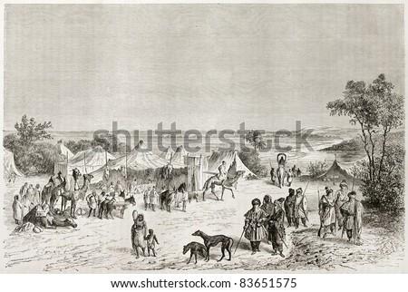 Tuareg encampment old illustration. Created by Lancelot after Barth, published on Le Tour du Monde, Paris, 1860 - stock photo