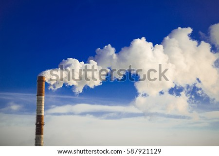 Tube factory smoke. Smoke from a pipe on a background of blue sky