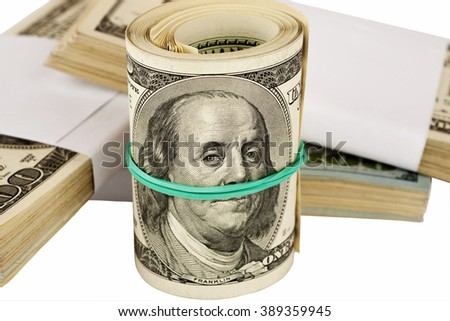 Tube of dollars with elastic band closeup, selective focus - stock photo