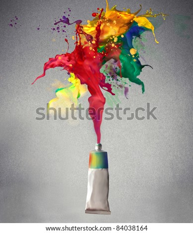 Tube spraying colored paint - stock photo