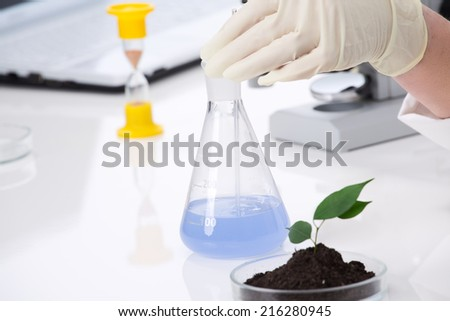 tube with a chemical solution - stock photo