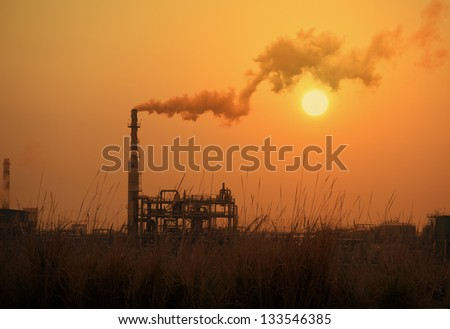 Tube with smoke on winter sunset,Global Warming concept. - stock photo