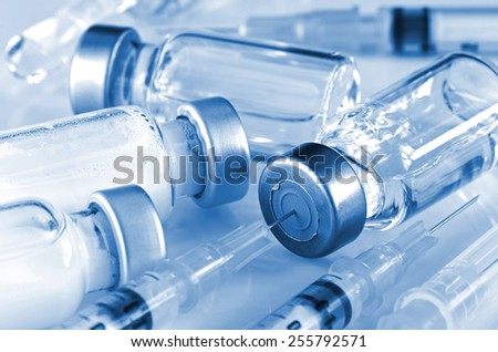 Tuberculin Syringe and Sterile Vial Filled with Medication Solution. An Injection Pharmaceutical Dosage Form. - stock photo