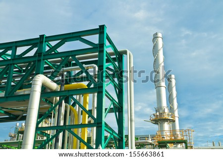 Tubes and  chimney in petrochemical plant in cloudy day  - stock photo
