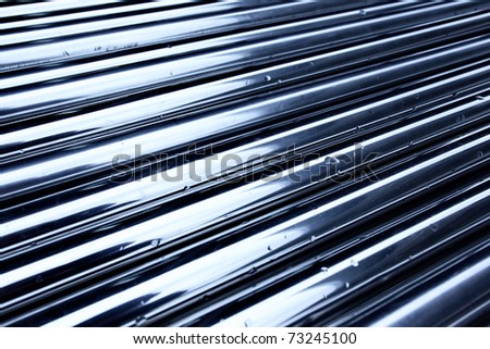 Tubes toned in blue color, may be used as industrial background - stock photo