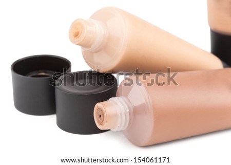 Tubes with make up liquid foundation, closeup on white background - stock photo