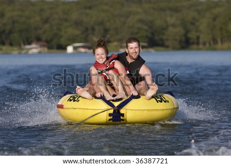 Tubing fun on a lake - stock photo