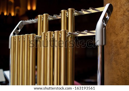 Tubular bells are a symphonic percussion instrument - stock photo