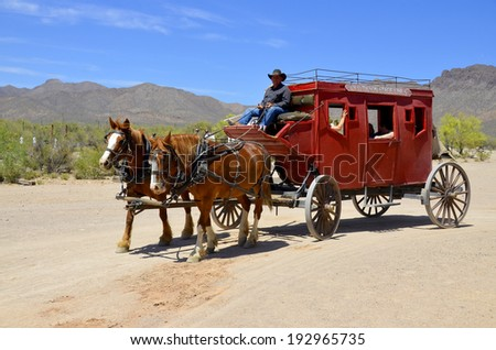 TUCSON ARIZONA APRIL 24: A vintage stagecoach at Old Tucson on april 24 2014 in Tucson Arizona. A stagecoach is a type of covered wagon used to carry passengers and goods inside. - stock photo