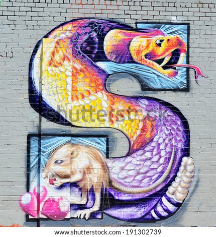 TUCSON AZ USA APRIL 24:Tucson S on wall on april 24 2014 in Tucson Arizona. Downtown Tucson is the place to experience the culture of the city. You can see the opera or ballet, street and public art - stock photo