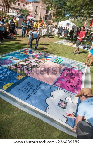 TUCSON, AZ/USA - OCTOBER 12:  Unidentifed people at AIDS Quilt Ceremony on October 12, 2014 in Tucson, Arizona, USA.