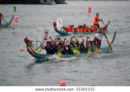 TUEN MUN, HONG KONG -  JUNE 16: Participants paddle their boats during a dragon boat race on June 16, 2010 in Tuen Mun, Hong Kong