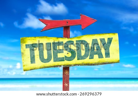 Tuesday sign with beach background - stock photo
