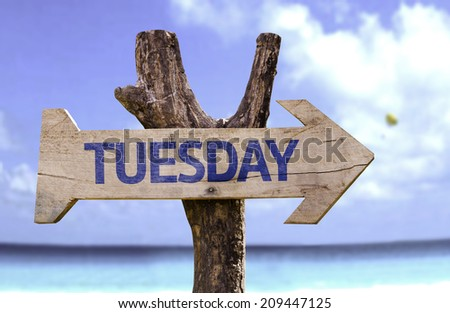Tuesday wooden sign with a beach on background  - stock photo