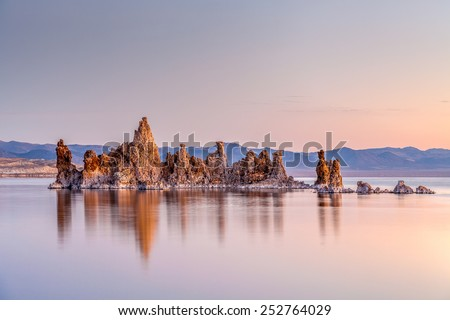 Tufa columns with reflection at sunrise, Mono Lake, California  columns at sunrise, Mono Lake, California - stock photo