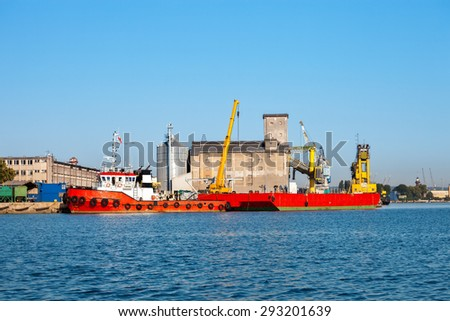 Tug boat and barge in port of Gdansk, Poland. - stock photo