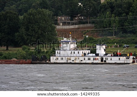 Tug boat and barge on Arkansas river - stock photo