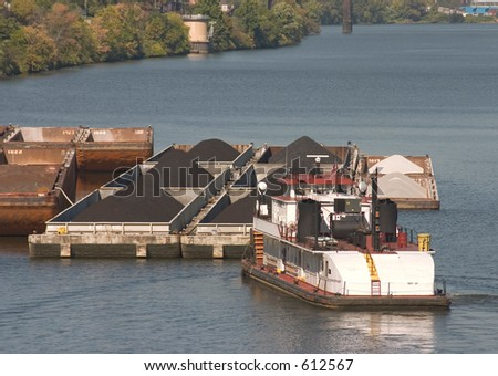 Tug boat and barges. - stock photo