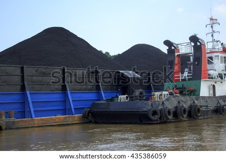Tug boat assist keep the other barge - stock photo