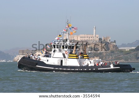 Tug Boat with Alcatraz in the foregroung - stock photo