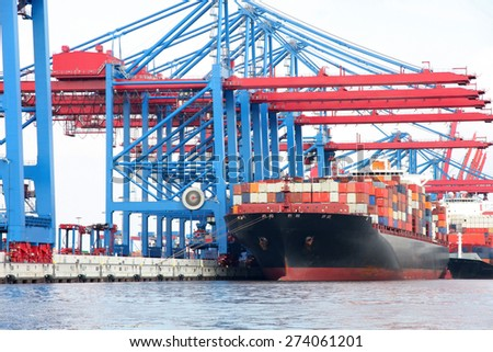Tug boat with large container ship, Port of Hamburg on the river Elbe, the largest port in Germany - stock photo