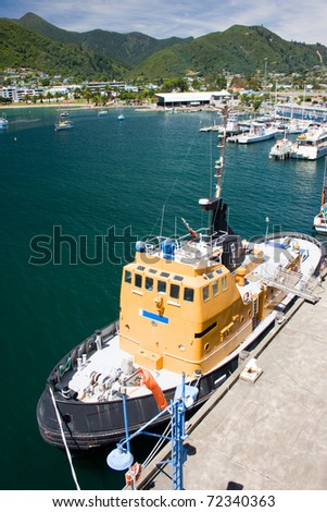 Tug in port of Picton, New Zealand - stock photo