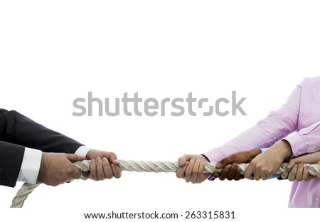Tug of war between businessman and business women - stock photo