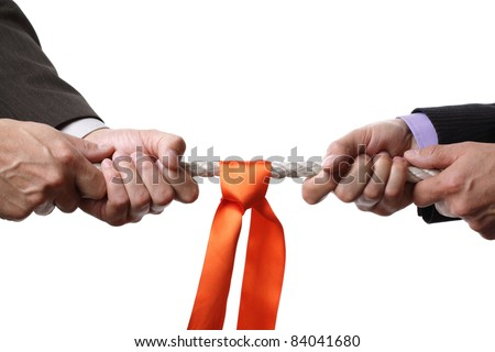 Tug of war concept for business rivalry, dispute or competition - stock photo