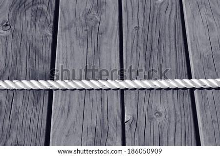 Tug of war on wooden planks background. business concept photo of  competition, challenge, achievement, determination, endurance, success. (BW) - stock photo