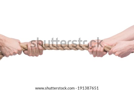 Tug-of-war. Two people pulling a rope in opposite direction isolated on white background. - stock photo