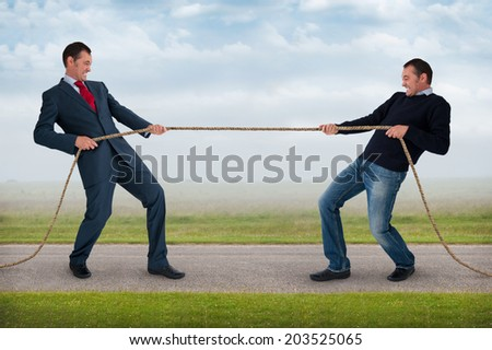 tug of war work life balance conflict concept - stock photo