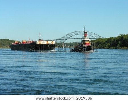 Tug pulling a fuel barge thru the Cape Cod Canal.