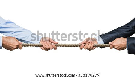 Tug war, two businessman pulling a rope in opposite directions isolated on white background - stock photo