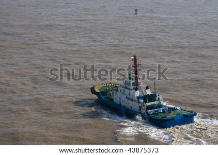 Tugboat and waves - stock photo