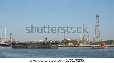 Tugboat cargo ship pulling on Chaopraya River  - stock photo