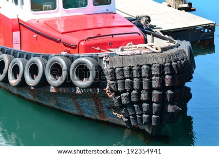 Tugboat docked at the Pier - stock photo
