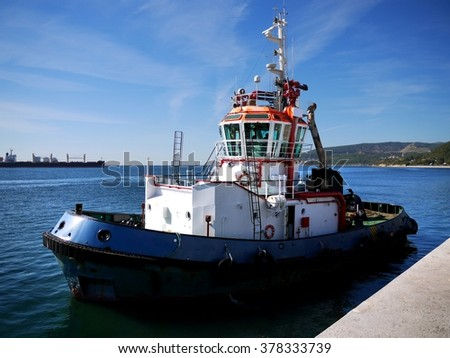 Tugboat, Harbor Tug leaving for towage operation. - stock photo