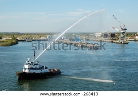 Tugboat in Galveston honoring first voyage out of harbor