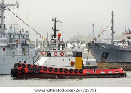 Tugboat in the Port Aquatorium - stock photo