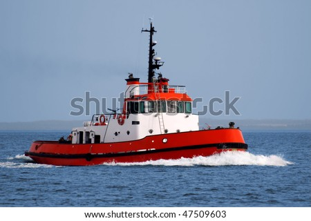 Tugboat underway at speed. - stock photo