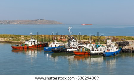 Tugboats in the port of Kavkaz, Taman Bay, Russia. In the background of the picture the Crimean Peninsula.