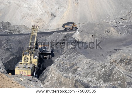 TUGNUI, RUSSIA - APRIL 2:  A mining shovel puts coal into a hauler at the opening of Tugnuiskaya coal-preparation plant on April, 2, 2008 in Tugnui, Buryatia, Russia.