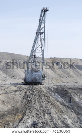 TUGNUI, RUSSIA - APRIL 2: The opening of Tugnuiskaya coal-preparation plant.  A giant mining shovel quarries, April, 2, 2008 in Tugnui, Buryatia, Russia. - stock photo