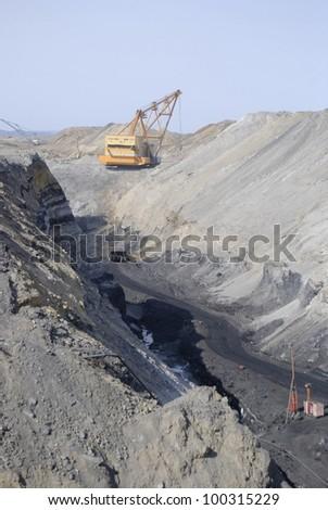 TUGNUI, RUSSIA - APRIL 2: The opening of Tugnuiskaya coal preparation plant.  A mining hauler moves along a coal pit, April 2, 2008 in Tugnui, Buryatia, Russia. - stock photo