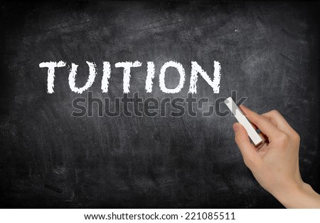 Tuition, written with white chalk on a blackboard - stock photo