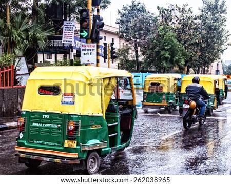 Tuk-tuk on the road in Delhi on March 03 01.2015 in India - stock photo