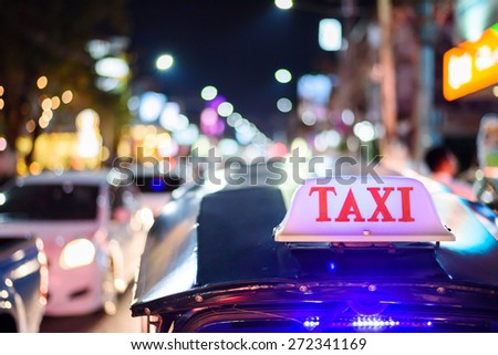 Tuk-Tuk Taxi  sign with defocused lights blur , Chiang Mai, Thailand - stock photo