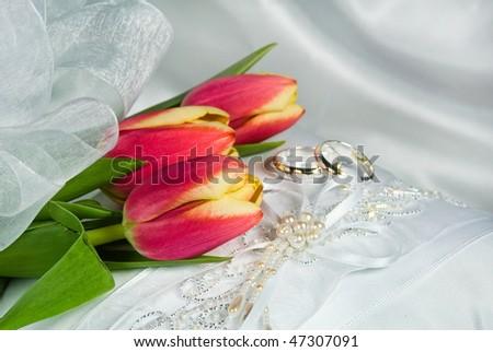 tulip bridal bouquet on pillow - stock photo