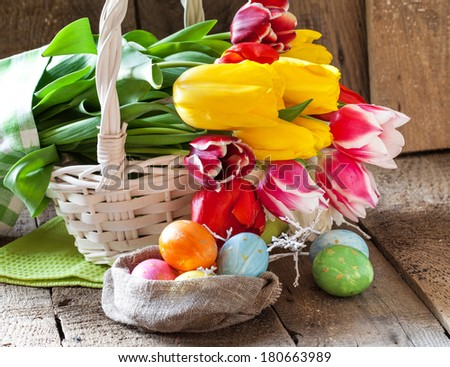 Tulip flowers in wooden background