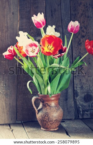 Tulip flowers in wooden background - stock photo